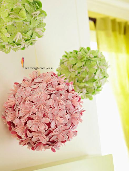 توپک گل های بهاری را به دیواری بالای شومینه تان آویزان کنید