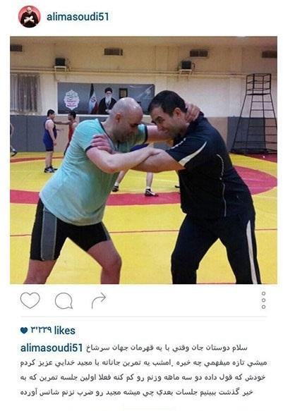 عکس کشتی گرفتن علی مشهدی با قهرمان جهان