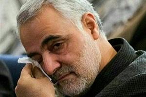 تصویری از سردار سلیمانی در حاشیه مراسم چهلم پدرشان