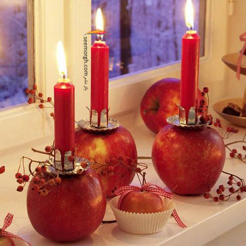 تزیین شمع برای شام شب یلدا با میوه های یلدایی - عکس شماره 1