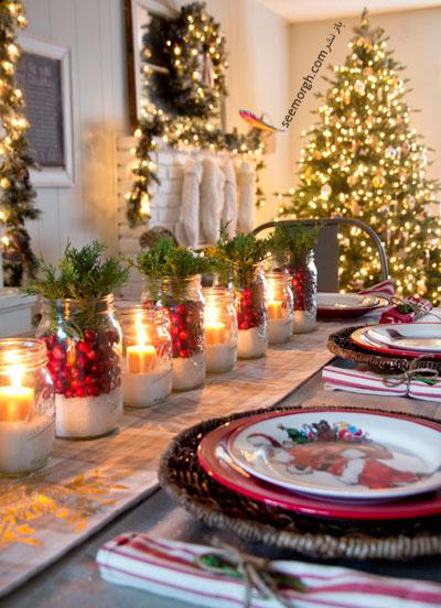تزیین میز شام کریسمس با شمع و میوه های مینیاتوری