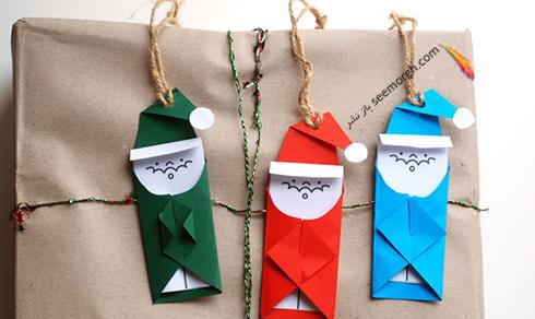 مرحله سوم درست کردن بابانوئل برای تزیین درخت کریسمس,کریسمس,کادو کریسمس,تزیین کادو کریسمس,ایده هایی برای تزیین کادو کریسمس,