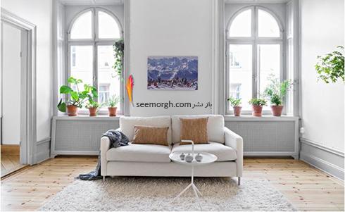 آویزان کردن یک اثر هنری از بیرون زدگی روی دیوار