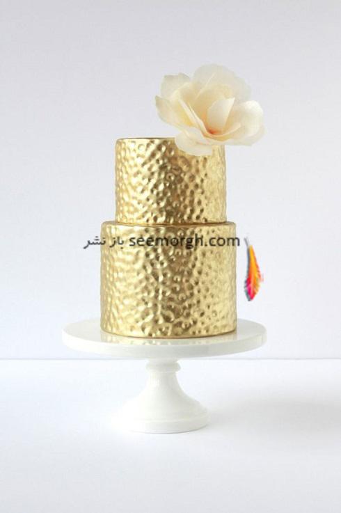کيک عروسي,کيک عروسي به رنگ طلايي,کيک عروسي با تم طلايي,کيک عروسي با ترکيب رنگي طلايي و خاکستري