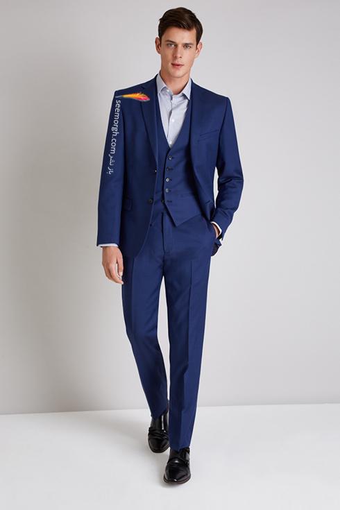 کت و شلوار دامادی 2018 آبی کاربنی تیره به پیشنهاد مجله مد Brides,کت و شلوار,کت و شلوار دامادی,انتخاب کت و شلوار,انتخاب کت و شلوار دامادی,جدیدترین مدل کت و شلوار,جدیدترین مدل کت و شلوار دامادی