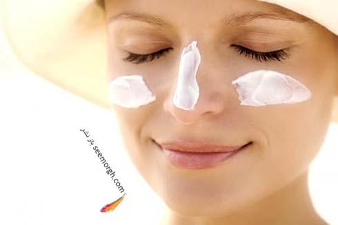 زن با ضد آفتاب روی صورت