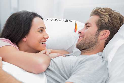 Cheerful-couple-awaking-and-looking-at-each-other.jpg