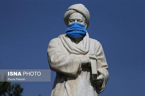 ماسک بر صورت مجسمه ابوعلی سینا همدان
