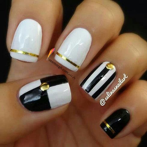 طراحی ناخن به رنگ سیاه و سفید نگین دار براق